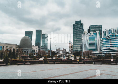 Elevated panoramic city view over Headquarters of the Nur Otan Party in Astana in Kazakhstan - Stock Photo