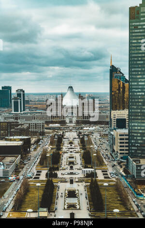Elevated panoramic city view over Astana in Kazakhstan with Khan Shatyr in background - Stock Photo