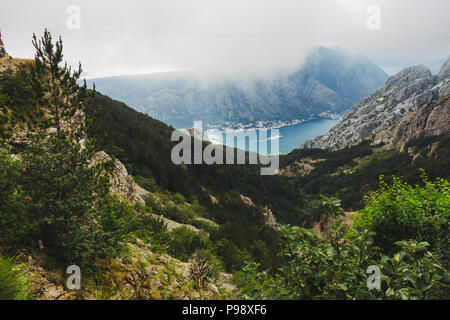 Cloud looms over the Bay of Kotor on an otherwise-sunny summer's afternoon in Kotor, Montenegro - Stock Photo