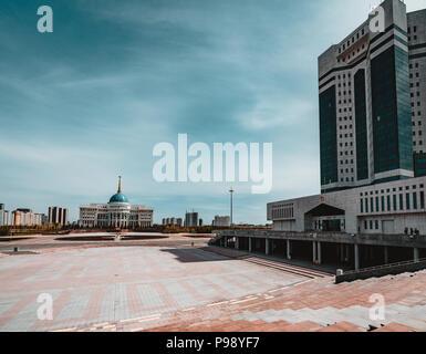 Presidential palace 'Ak-Orda' with blue sky across river in Astana, Kazakhstan - Stock Photo