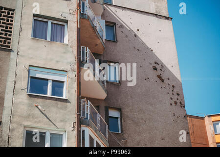 Holes from shell shrapnel still marks the walls of many buildings and homes in Sarajevo, Bosnia and Herzegovina, decades after the seige ended - Stock Photo