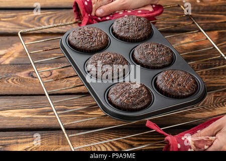 Basic homemade brownie or chocolate muffins raw dough in baking pan. Cooking homemade chocolate muffins, cupcakes - Stock Photo