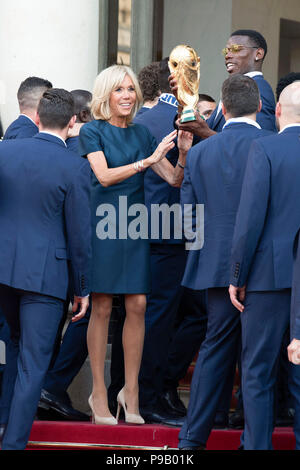 Paris, France. 16th July, 2018. French first lady Brigitte Macron (L) interacts with the player Paul Pogba (R) at the Elysee Palace in Paris, France, on July 16, 2018. The French President Emmanuel Macron geeeted on Monday the winning French Football Team. Credit: Jack Chan/Xinhua/Alamy Live News - Stock Photo