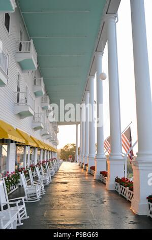 World's longest porch at sunrise at the Historic Grand Hotel on resort island (and state park) of Mackinac Island, Michigan, USA. - Stock Photo