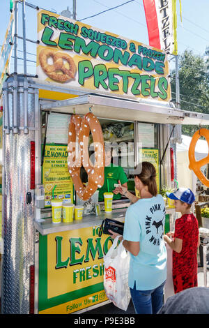 Florida Micanopy Fall Harvest Festival annual small town community event booths stalls vendors buying selling food trailer truck pretzels lemonade wom - Stock Photo