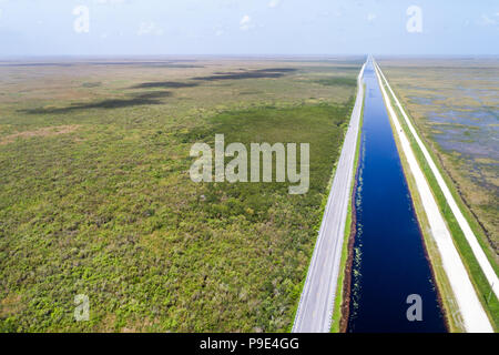 Miami Florida Everglades National Park Tamiami Trail US route 41 highway canal levee water conservation area 3A freshwater slough aerial overhead bird - Stock Photo