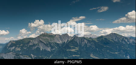 panorama view of mountain landscape in Switzerland near Maienfeld in the summertime - Stock Photo