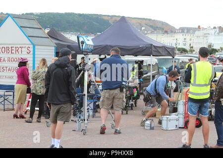 Eddie Izzard Filming Six Minutes to Midnight on Landudno Promenade Wales - Stock Photo