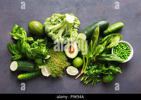 Set raw healthy food clean eating vegetables source of protein for vegetarians: cucumber, lucerne, zucchini, spinach, basil, green peas, avocado, broc - Stock Photo