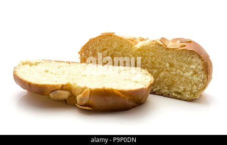 Two sliced pieces of braided bread isolated on white background - Stock Photo