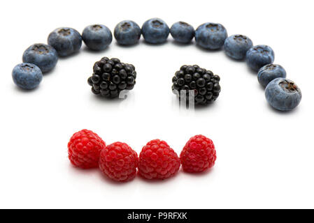 Heart by berries isolated on white background blackberry blueberry and raspberry - Stock Photo