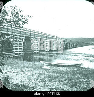 . English: Bridge Across Mouth of the Nerepis River, Westfield, Kings County, New Brunswick, Canada. circa 1875 245 Bridge across Nerepis River Westfield 1875 - Stock Photo