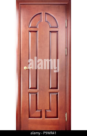 Wooden interior carved door in a door frame made of cherry tree with a brass handle with geometric ornaments isolated on white background - Stock Photo