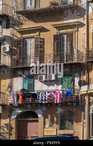 Sicily, Palermo - an old apartment block with laundry hanging in Palermo, Sicily, Italy, Europe - Stock Photo