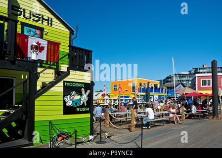 Fisherman's Wharf in Victoria, British Columbia, Canada.  Restaurants and boardwalk in Victoria, BC, Canada. - Stock Photo