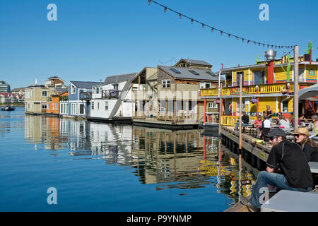 Fisherman's Wharf in Victoria, British Columbia, Canada.  Colourful float homes and restaurant at Fisherman's Wharf in Victoria, BC. - Stock Photo
