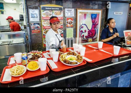 Fort Ft. Pierce Florida La Granja restaurant Peruvian food casual dining typical food Hispanic woman counter server trays plates Styrofoam cups employ - Stock Photo