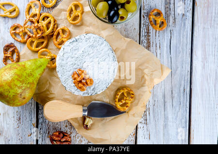 curd head blue cheese and olives. honey and pear,  pretzel on white old wooden table, top view - Stock Photo