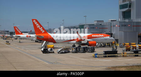 EasyJet planes on the apron at London Gatwick Airport, UK - Stock Photo