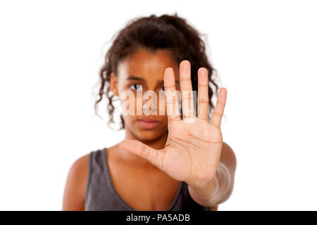 sad african girl shows a stop hand - Stock Photo