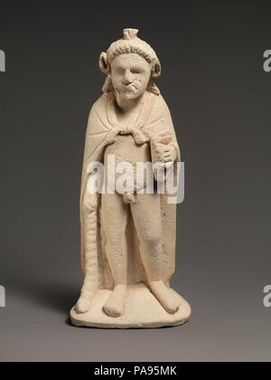 Limestone statuette of Pan or Opaon Melanthios. Culture: Cypriot. Dimensions: Overall: 12 1/2 x 5 1/2 x 2 3/4 in. (31.8 x 14 x 7 cm). Date: 3rd century B.C..  This figure with the horns and ears of a goat wears an animal skin and holds a syrinx (double pipes) and a pedum (shepherd's crook). Images of this type first appeared in Cypriot sanctuaries during the Hellenistic period. They may represent Pan, the Greek god who protected herdsmen and shepherds, or they may be associated with Opaon Melanthios, a Cypriot deity of rural life and fertility, who is known from inscriptions. Museum: Metropoli - Stock Photo
