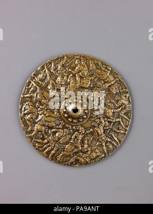 Battle Scene. Culture: South German or North Italian. Dimensions: Diam. 9.1 cm, wt. 94.54 g.. Date: model third quarter 16th century (cast late 16th or 17th century).  This piece is the central decoration of a shield or the foot of a tazza, in the shape of a circular shield decorated with a continuous all'antica battle scene. Such imagery was particularly popular in sixteenth-century Southern Germany, as demonstrated by the prints of Hans Sebald Beham, Barthel Beham, and Jost Amman.  The high quality of this composition, with a remarkable variety of poses, suggests that the modeler was inspire - Stock Photo