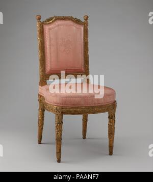 Side chair (chais à la reine) (one of a pair). Culture: French, Paris. Dimensions: 34 x 18-1/2 x 18 in.  (86.4 x 47.0 x 45.7 cm). Maker: Georges Jacob (French, Cheny 1739-1814 Paris); Carved by Jules-Hugues Rousseau (1743-1806) and; Jean -Siméon Rousseau de la Rottière (1747-1820); Gilded by Presle. Date: 1784.  'At eleven o'clock set out for the Thuilleries, to see the balloon go off; we soon quitted the coach, and it was with the greatest difficulty we got through the crowd on the Pont-royal to the little garden door. It was not long afterwards, that the Duke of Cumberland was in danger of b - Stock Photo