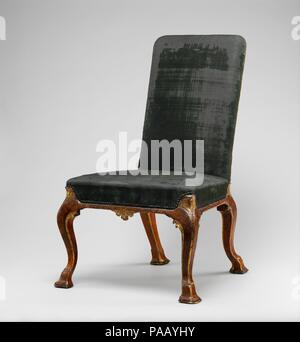 Side chair (one of a pair). Culture: British. Dimensions: Overall: 41 3/4 × 25 × 29 in. (106 × 63.5 × 73.7 cm). Maker: Attributed to Richard Roberts (British, active 1714-29). Date: ca. 1715.  These chairs are part of a large set that included two settees and one winged easy chair, stools, and side chairs, supplied to Sir Robert Walpole, later first Earl of Orford (1676-1745), for Houghton Hall, Norfolk. The attribution to Richard Roberts is based on an account of a considerable debt owed by Walpole in 1729 to a 'Thomas Roberts.' Thomas Roberts, carver and joiner to the royal household, worked - Stock Photo