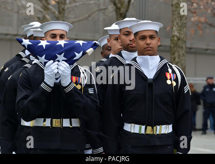 160315-N-LV695-012 NEW YORK (March 15, 2015) U.S. Navy Ceremonial Guardsmen stand by awaiting a flag presentation at the 9/11 Memorial Museum. The Ceremonial Guard is the Navy's most prestigious unit and conducts ceremonies for Presidential inaugurations, distinguished visitors, and burials at Arlington National Cemetery. (U.S. Navy photo by Mass Communication Specialist 2nd Class Destiny Cheek/Released) - Stock Photo