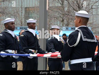 160315-N-LV695-047 NEW YORK (March 15, 2015) U.S. Navy Ceremonial Guardsmen conduct a flag presentation at the 9/11 Memorial Museum. The Ceremonial Guard is the Navy's most prestigious unit and conducts ceremonies for Presidential inaugurations, distinguished visitors, and burials at Arlington National Cemetery. (U.S. Navy photo by Mass Communication Specialist 2nd Class Destiny Cheek/Released) - Stock Photo