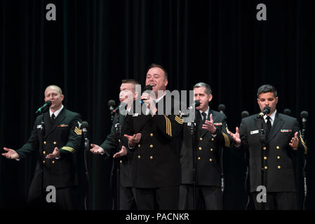 SWARTZ CREEK, Mich. (April 22, 2017) Musician 1st Class Michael Webb performs a solo with the small group, The Sideboys, during a medley of Motown hits. The Sea Chanters are on a 21-day tour of the midwestern United States connecting communities across the United States to their Navy. - Stock Photo