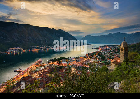 Stunning sunset over Bay of Kotor and Church of Our Lady of Health in Montenegro - Stock Photo