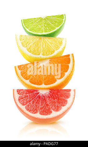 Isolated citrus fruits wedges. Pieces of grapefruit, orange, lemon and lime on top of each other isolated on white background with clipping path - Stock Photo