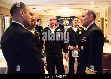 Rear Adm. Michael C. Manazir, director of air warfare, right, speaks with Sailors assigned to Navy Recruiting District New York at the conclusion of his presentation to members and guests of the New York Council of the Navy League as part of their breakfast speaker series, 'Warfighting in the 21st Century,' at the Cornell Club in New York City, March 23. Manazir's presentation and follow on discussion focused on the state of naval aviation, the service's efforts to integrate networks and capabilities across warfighting platforms and how the Navy will meet future challenges. (U.S. Navy photo by - Stock Photo