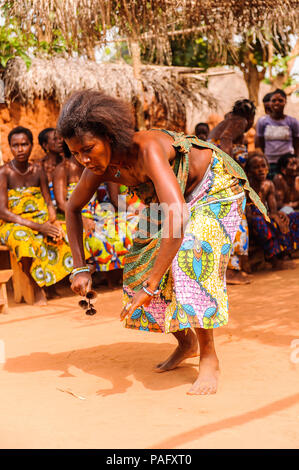KARA, TOGO - MAR 11, 2012:  Unidentified Togolese woman in a traditional dress dances the religious voodoo dance. Voodoo is the West African religion - Stock Photo