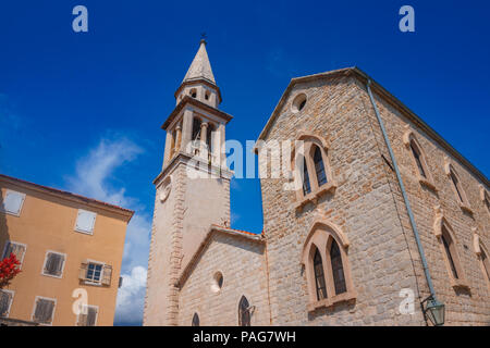 Saint John cathedral in Budva coastal town in Montenegro against a deep blue sky. - Stock Photo