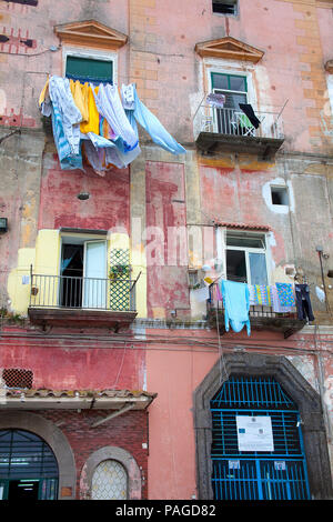 House facade with out hanging laundry, fisherman's house at Marina Grande, Procida island, Gulf of Naples, Italy - Stock Photo