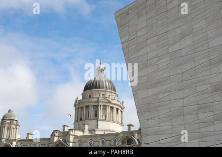 The dome of the Port of Liverpool building contrasts with the prowlike Museum of Liverpool building. - Stock Photo