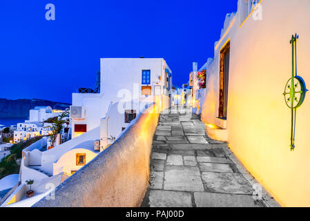 Santorini, Greece. Twilight amazing view of Oia, whitewashed city from Thira, Greek Islands. Europe holiday destination. - Stock Photo