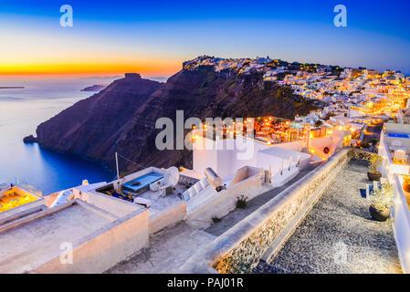 Santorini, Greece. Firostefani twilight, old village in Thira island, Cyclades at Aegean Sea. - Stock Photo