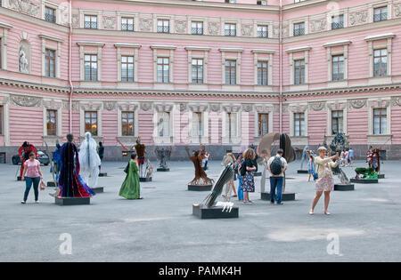 SAINT-PETERSBURG, RUSSIA – JULY 23, 2018: People look at the  modern sculptures In Dante Veritas by Vasily Klyukin in the yard of Mikhailovsky Castle - Stock Photo