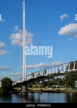 Reading, United Kingdom - June 21 2018:   The new Christchurch pedestrian suspension bridge over the River Thames ona  sunny day. - Stock Photo