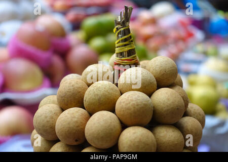 Colorful tropical Longan Fruit Cluster in Southeast Asian food market - Intramuros, Manila - Philippines - Stock Photo