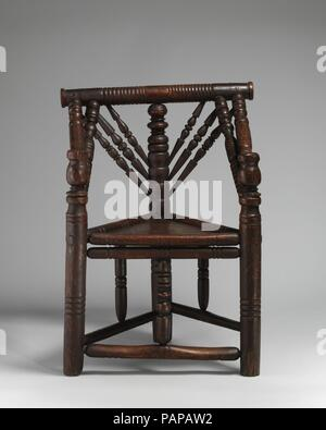 Three-legged chair. Culture: British. Dimensions: Height: 32 1/2 in. (82.6 cm). Date: late 16th-early 17th century. Museum: Metropolitan Museum of Art, New York, USA. - Stock Photo