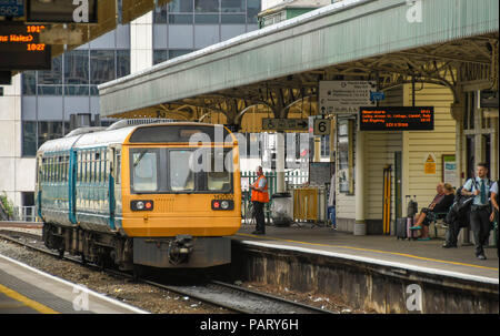 Diesel commuter train alongside a platform at Cardiff Central Station - Stock Photo