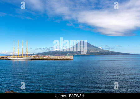 Santa Maria Manuela is a Portuguese four mast lugger in Horta harbor with Mount Pico behind, ,  Faial Island, Azores, Portugal - Stock Photo