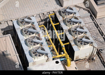 Air compressors and pipe system on the roof of a building - Stock Photo