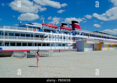 3 deck ship on river jetty waiting new passengers in trip - Stock Photo