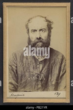 Dupuis. Augustin. 53 ans, né le 24/6/41 à Dourdan (Seine & Oise). Charron, forgeron. Anarchiste. 3/7/94. Artist: Alphonse Bertillon (French, 1853-1914). Dimensions: 10.5 x 7 x 0.5 cm (4 1/8 x 2 3/4 x 3/16 in.) each. Date: 1894.  Born into a distinguished family of scientists and statisticians, Bertillon began his career as a clerk in the Identification Bureau of the Paris Prefecture of Police in 1879. Tasked with maintaining reliable police records of offenders, he developed the first modern system of criminal identification. The system, which became known as Bertillonage, had three components - Stock Photo