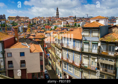 View over the rooftops of Porto from in front of Museu do Tesouro da Sé with the Clérigos Tower in the background - Stock Photo